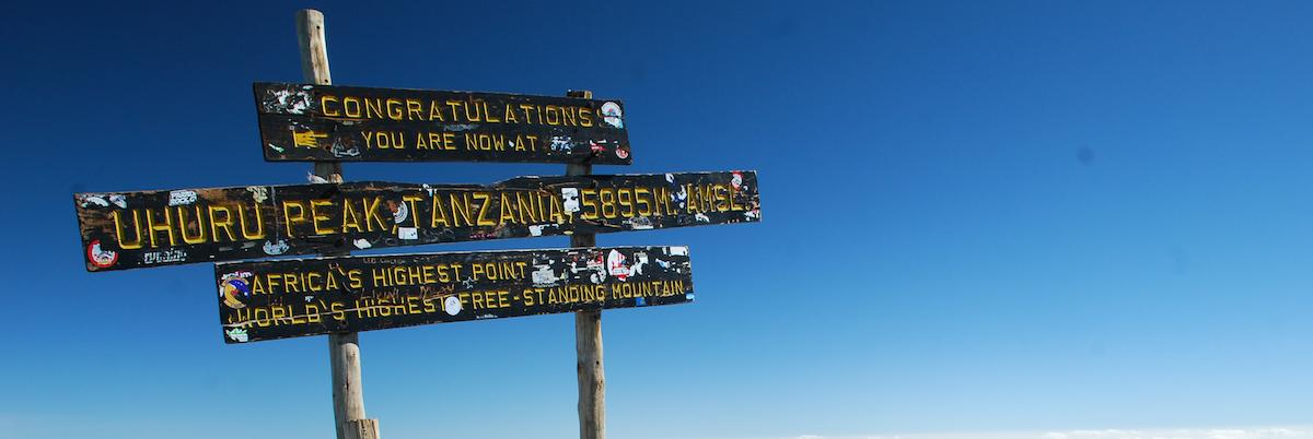 The old wooden sign at the top of Kilimanjaro