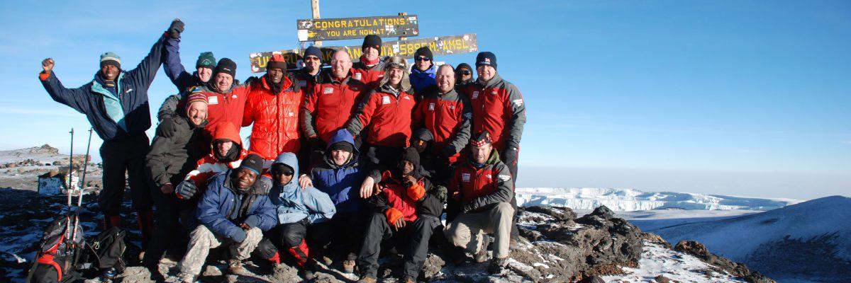 Climb with us group at Uhuru Peak banner 4