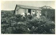 Wooden Peters Hut, which no longer exists, on the slopes of Kilimanjaro with Mawenzi behind.