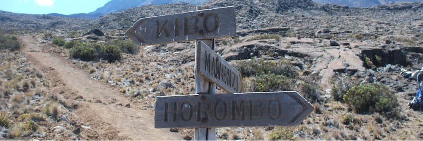 Signpost on the mountain pointing out the various routes on Kilimanjaro