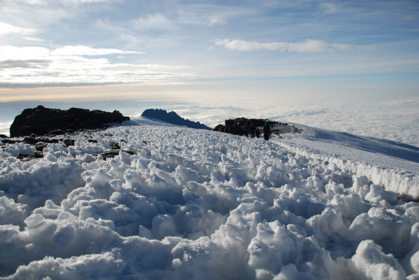 Meringue-style peaks of snow on Kilimanjaro's Kibo summit looking down to the top of Mawenzi just visible in the distance