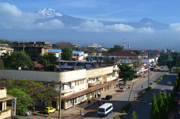 The twin peaks of Kilimanjaro from a hotel terrace in Moshi