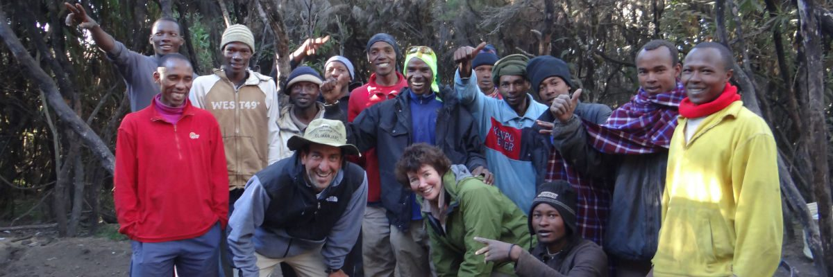 Porters and trekkers posing at Mweka Camp