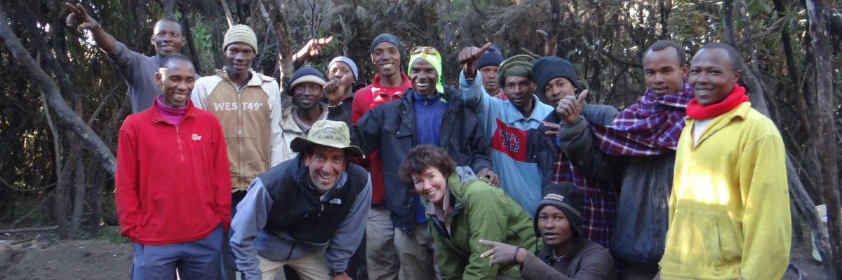 Porters and trekkers posing at Mweka Camp