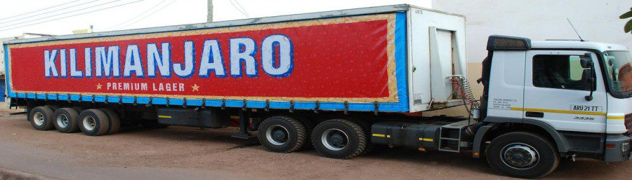 A large red Kilimanjaro beer lorry