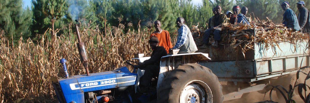 Tractor in Tanzania carrying people
