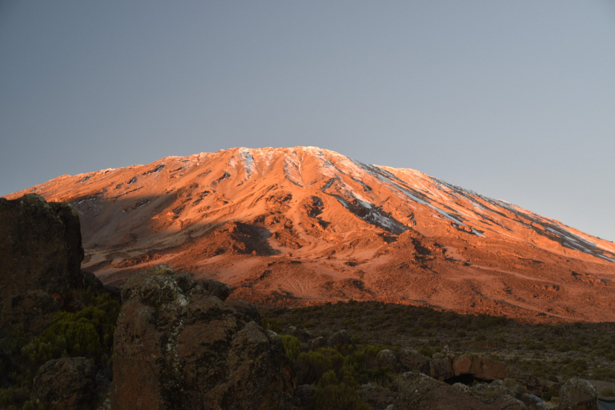 Kibo glows orange in the sunset, from Third Cave Campsite